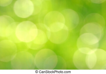 Fuzzy and Blurred Brigth Green Lights as Abstract Holiday Background