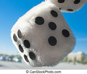 Fuzzy dice hanging from rear view mirror
