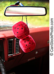 Fuzzy Mirror Dice - Fuzzy red dice hanging on the rearview...