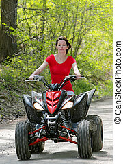 fyra hjuling, kvinna, röd