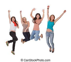 fyra, ung kvinna, hoppa för glädje
