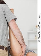 fysiotherapeut, het manipuleren, de, been, van, een, patiënt