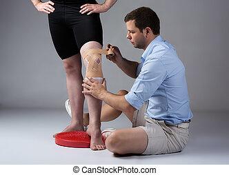 fysiotherapeut, mannelijke volwassene