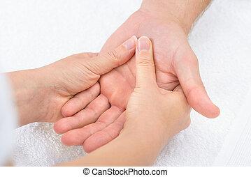 fysiotherapeut, masserende handen, palm