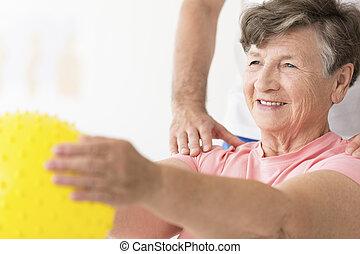 fysiotherapie, bal, vasthouden, vrouw