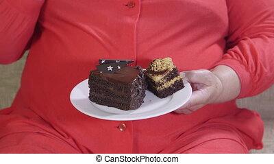 gâteau, femme mange, graisse