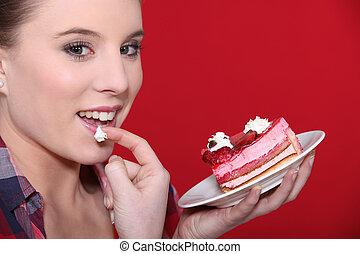 gâteau, femme mange