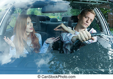 Gabby woman in a car