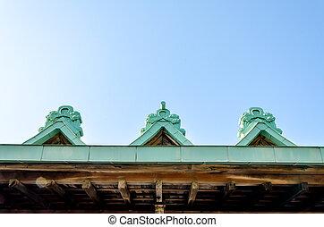 gable apex on blue sky with cloud