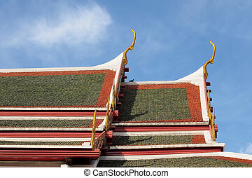 gable apex on temple roof with blue sky background