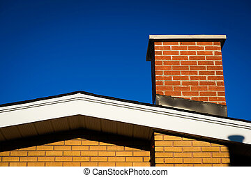 Gable of Brick House With Brick Chimney