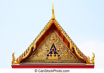 Gable roof on Thai temple with blue sky in Bangkok, Thailand...