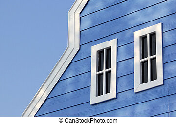 gable roof with windows on wooden house