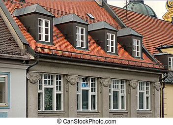 Typical red tiled building and dormer windows found in Munich, Germany