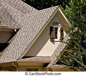 Gables and Shingles on Roofline of a House