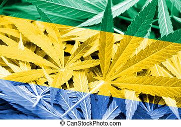 Gabon Flag on cannabis background. Drug policy. Legalization...