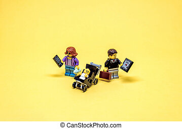 Gadget addicted parents. Illustrative editorial. July 15, 2021