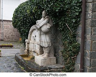 Gaidar (bagpiper)- City fountain in the village of Shiroka Laka - Bulgaria