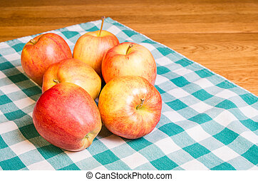 Gala apples on checked cloth
