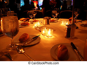 round table appointments with candles on gala dinner in restaurant