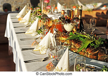 gala reception, places ready for guests. table with food and...