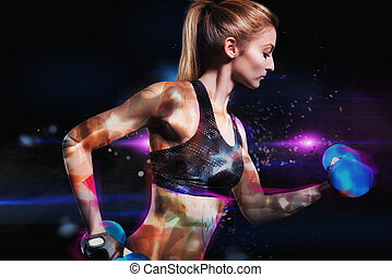 Galactic power workout - Muscular woman is training with...