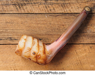 Galangal on wooden table