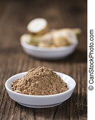 Galangal Powder(detailed close-up shot) on an old wooden ...