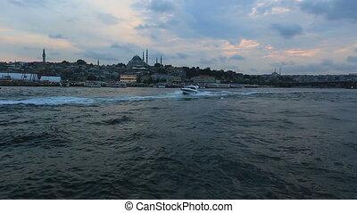 galata bridge and speed boat at istanbul turkey