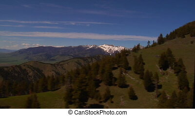 Gallatin Valley Montana - forested mountains, distant snow