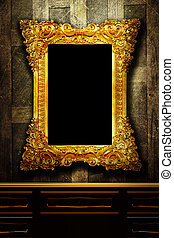 Gallery display - vintage gold frames on an old timber wall