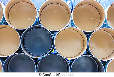 gallon chemical drums in a storage yard awaiting recycling