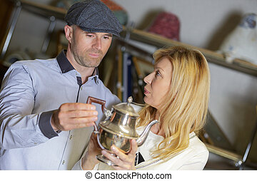 galmorous couple buying antiques at flea market
