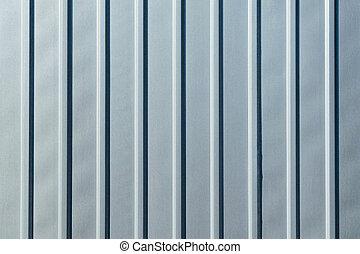 Galvanized sheet metal with longitudinal ribs. Sheet metal gray color.