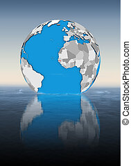 Gambia on globe in water