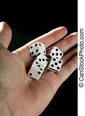 Gambler five dices in human hand