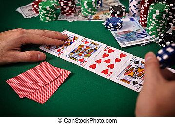 Gambler playing poker cards