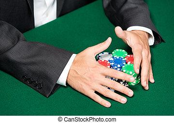 Gambler raking a big pile of chips
