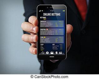 gambling businessman smartphone - gambling concept:...