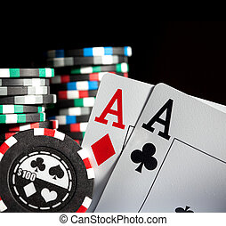 gambling chips and aces - Photo gambling chips on the dark