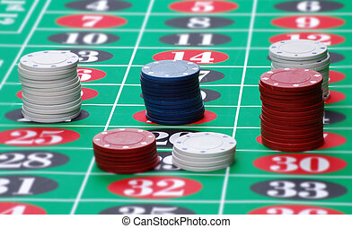 Gambling chips in table