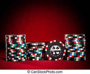 gambling chips on the red background