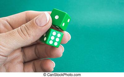 Gambling dice on poker table