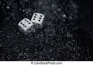 Gambling dices under the rain