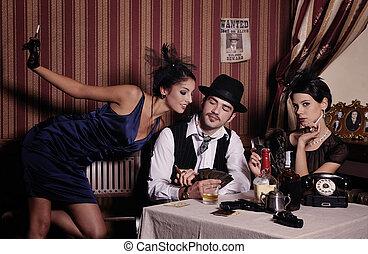 Gambling mafia type with cigarette, playing poker. -...