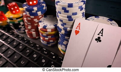 Gambling Money Chips Poker Cards and Dices on Laptop...