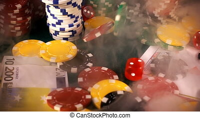 Gambling Red Dices Poker Cards and Money Chips in Smoke
