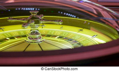 Gambling roulette spinning in casino