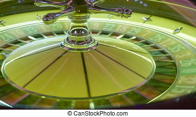 Gambling roulette spinning in casino. Fortune and luck