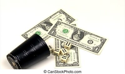 Gambling - Dices and dollar bils on a rotating platform
